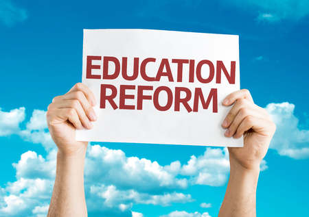 reformation: Hands holding Education Reform card with sky background Stock Photo