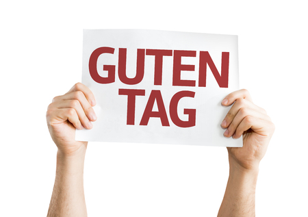 guten tag: Hands holding Good Day (in German) card isolated on white background