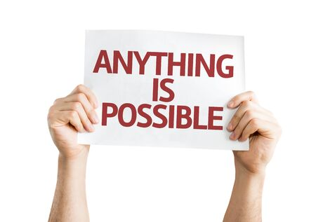 anything: Hands holding Anything is Possible card isolated on white background
