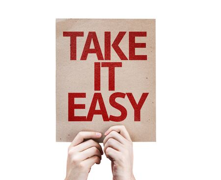 take it easy: Hands holding Take It Easy card isolated on white background Stock Photo