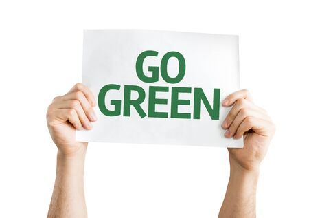 go green background: Hands holding card with text: Go Green isolated on white background