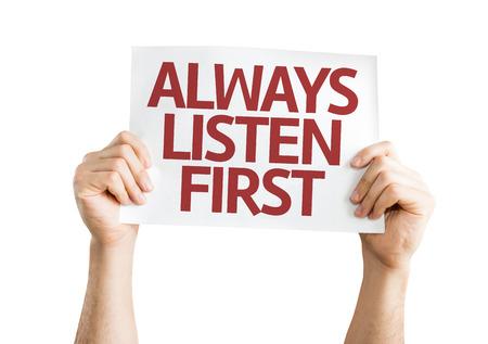 always listen first: Hands holding Always Listen First card isolated on white background