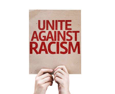 racismo: Hands holding Unite Against Racism card isolated on white background Foto de archivo