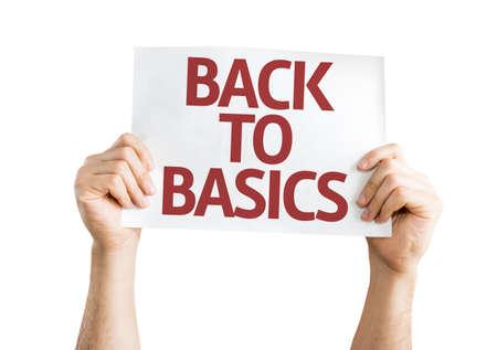 basic scheme: Hands holding Back to Basics card isolated on white background Stock Photo