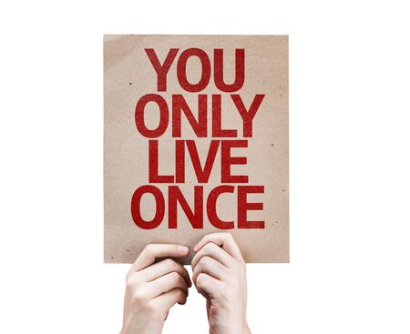 cardboard only: Hands holding You Only Live Once card isolated on white background