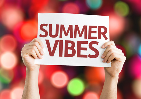 vibrations: Hands holding Summer Vibes card with colorful background with defocused lights Stock Photo