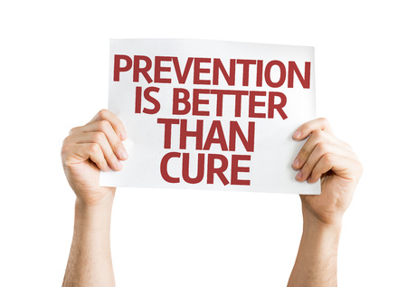 better: Hands holding Prevention is Better than Cure card isolated on white background Stock Photo