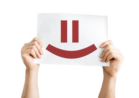 emote: Hands holding card with a smiley face isolated on white Stock Photo