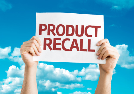 recall: Hands holding Product Recall card on sky background