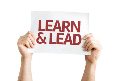 learn and lead: Hands holding Learn & Lead card isolated on white background