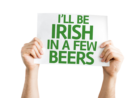 Hands holding I'll Be Irish in a Few Beers card isolated on white background