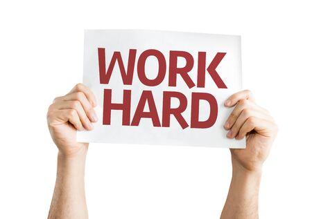 white work: Hands holding Work Hard card isolated on white background Stock Photo