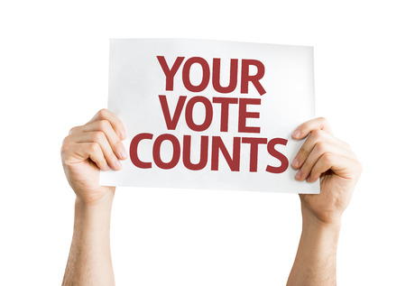 Hands holding Your Vote Counts card isolated on white background