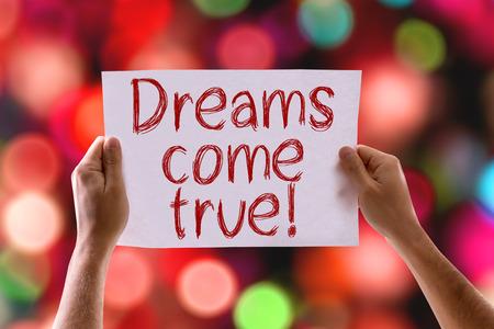 Handen die Dreams Come True kaart met bokeh achtergrond