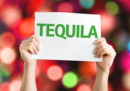 beverage display: Hands holding Tequila card with colorful background with defocused lights