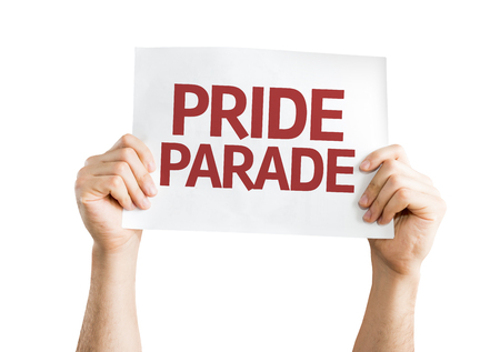 transexual: Hands holding Pride Parade card isolated on white background