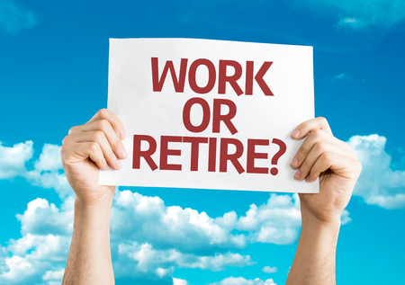 retire: Hands holding Work or Retire? card with sky background