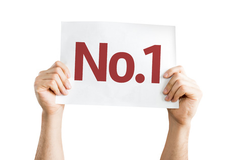 no1: Hands holding No.1 card isolated on white background Stock Photo