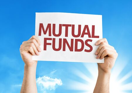mutual funds: Hands holding Mutual Funds card with sky background Stock Photo