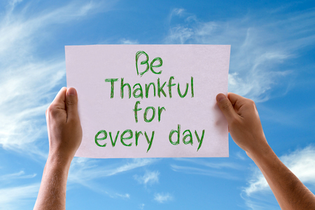 thankfulness: Hands holding Be Thankful for Every Day card with sky background