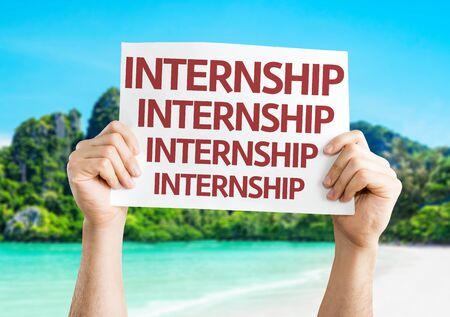 internship: Hands holding Internship card with beach background