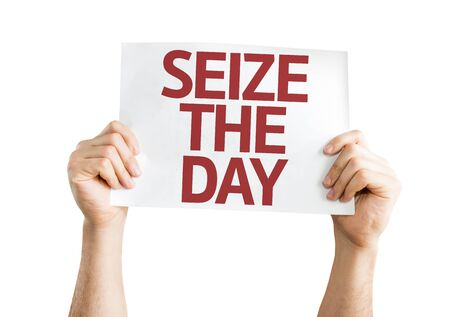 seize: Hands holding Seize The Day card isolated on white background Stock Photo