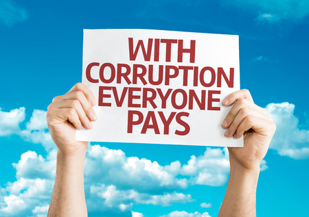 immoral: Hands holding With Corruption Everyone Pays card with sky background