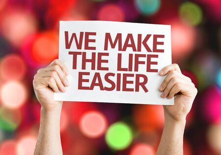 easier: Hands holding We Make the Life Easier card bokeh