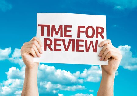 performance appraisal: Hands holding Time For Review card with blue background