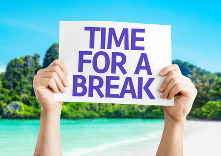 time travel: Hands hold Time for a Break card with beach background