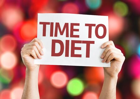 exercise weight: Hands holding Time To Diet cardboard with bokeh background Stock Photo