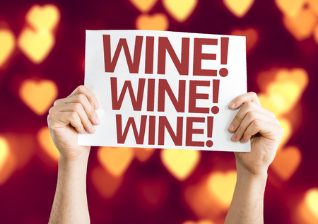 beverage display: Hands holding Wine! card with heart bokeh background Stock Photo
