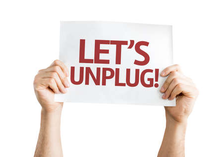 unplug: Hands holding Lets Unplug card isolated on white background