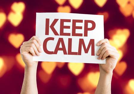 sooth: Hands holding Keep Calm card with heart bokeh background Stock Photo