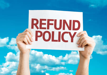 refund: Hands holding Refund Policy card with sky background
