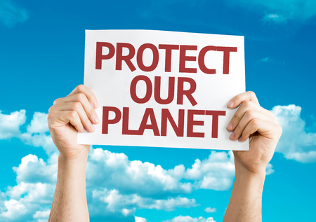 our: Hands holding Protect Our Planet card with sky background