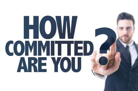 committed: Business man pointing the text: How Committed Are You?