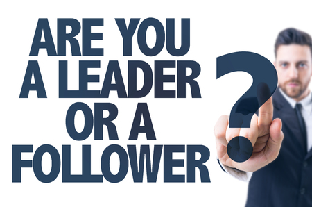 follower: Business man pointing the text: Are You a Leader or a Follower? Stock Photo