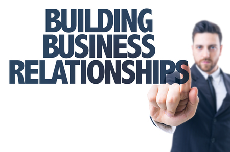 Business man pointing the text: Building Business Relationships Stock Photo