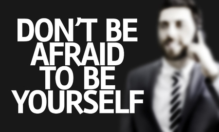 be yourself: Business man with the text Dont Be Afraid to be Yourself in a concept image