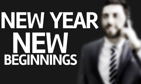new beginnings: Business man with the text New Year New Beginnings in a concept image