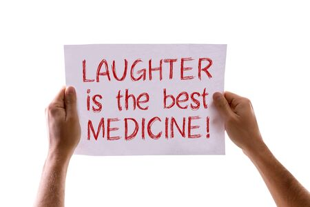 longevity drugs: Hands holding cardboard with Laughter is the Best Medicine isolated on white background Stock Photo