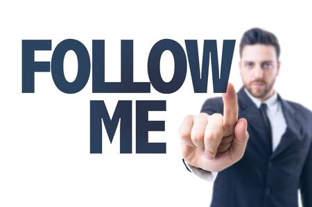 Business man pointing the text: Follow Me