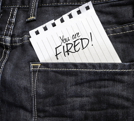 you are fired: You Are Fired! written on a piece of paper on a jeans background