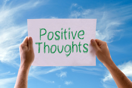 positiveness: Hands holding Positive Thoughts card with sky background