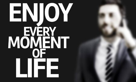 every: Business man with the text Enjoy Every Moment of Life in a concept image