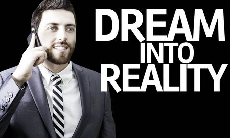 black empowerment: Business man with the text Dream Into Reality in a concept image Stock Photo