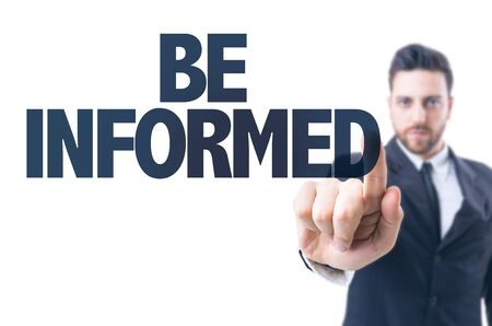 informed: Business man pointing the text: Be Informed Stock Photo