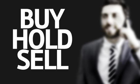 buy sell: Business man with the text Buy Hold Sell in a concept image