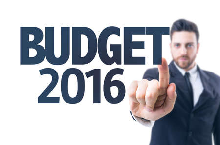 money matters: Business man pointing the text: Budget 2016